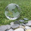 Globe and coins — Stock Photo #58373093