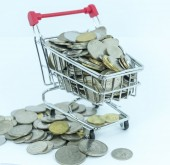 Coins and trolley — Stock Photo