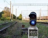 Traffic light controller with blue light near the rails — Stock fotografie