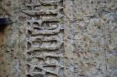 Starověké gravírování na kameni s texturou, ve věku — Stock fotografie