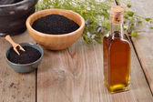 Nigella sativa oil. — Stock Photo