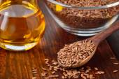 Flaxseeds and linseed oil. — Stock Photo