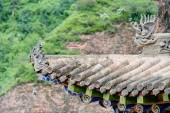 PINGAN, CHINA - Jul 9 2014: Roof of Shazong Ritod Monastery(Xiazongsi). a famous Monastery in Pingan, Qinghai, China. — Stock Photo