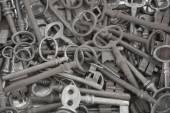 Ot of old metal keys as background — Stok fotoğraf