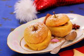 Two baked apples as Christmas Dessert — Stock Photo