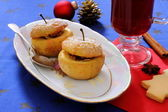 Baked apples as Christmas dessert and mulled wine — Stock Photo