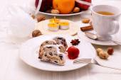 Christmas stollen cake with winter tea — Stock Photo