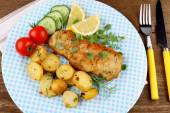 Fish fillet with rosemary potatoes, vegetables — Stock Photo