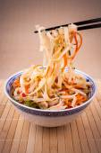 Rice noodle with chopsticks taken, close up — Stock Photo