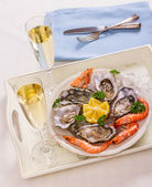 Champagne glasses, oysters shell with shrimp on serving tray — Stock Photo
