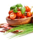 Cherry tomatoes and greens in bowl — Stock Photo