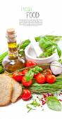 Olive oil with Cherry Tomatoes, chives and peppers — Stock Photo