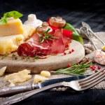 Various cheeses, salami and mushrooms — Stock Photo #67223187