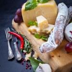 Various cheeses and salami — Stock Photo #67225591