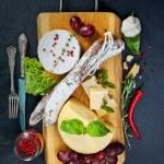 Various cheeses and salami — Stock Photo #67225661