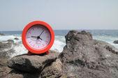 Red Clock Near the Ocean — Stock Photo
