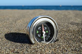 Tourist Compass in the Sand — Stock Photo