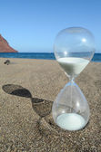 Hourglass on a Beach — Stock Photo