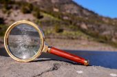 Magnify Glass Loupe on the Volcanic Rock — Stock Photo