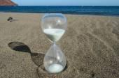Hourglass on a Beach — Stock Photo
