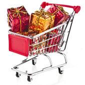 Regalos de navidad en carrito de compras — Foto de Stock