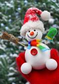 Christmas snowman in hand — Stock Photo