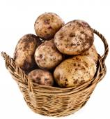Potatoes heap in basket isolated — Stock Photo