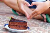 Chocolate cake and handshake symbol of love. — Stock Photo