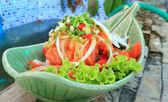 Fresh salmon salad with spices — Stock Photo
