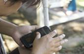 Blurred women using smart phone — Stock Photo