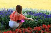 Blurred woman in a flower garden — Stockfoto