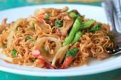Fried pork chops drunken noodles — Stock Photo