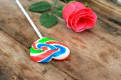 Candy valentines hearts and red rose — Stock Photo