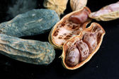 Heap of moldy peanuts on a black background — Stock Photo