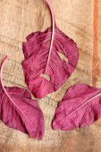 Red spinach on a wooden vintage — Stock Photo