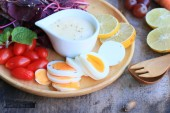 Fresh red spinach salad and cream on wooden table — Stock Photo