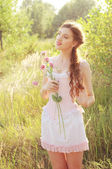 Young bride in a pink corset outdoors — Stock Photo