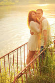 Couple of young lovers  on the pier — Fotografia Stock