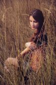 Cute young woman in the autumn field — Stock Photo