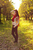 Young redheaded woman with long straight hair in the apple garde — Stock Photo