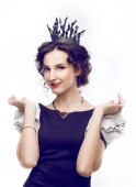 Studio portrait of a beautiful brunette with a crown — Stock Photo