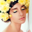 Girl with flower wreath. Caucasian woman with suntanned glowing — Stock Photo #73149133