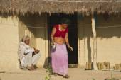 Couple of ethnic taru people in traditional house in Nepal — Stock Photo