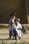 Two young girl from terai village are waiting to go at school — Stock Photo
