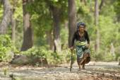 Very old tharu woman walking in jungle in Bardia, Nepal — Stock Photo