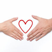 Two hands with red heart — Stock Photo