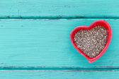 Heart shape ceramic bowls with Chia seeds — Stock Photo