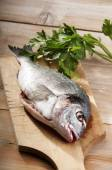 Sea bream with parseley — Stock Photo