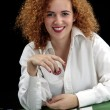 Woman croupier at the green table — Stockfoto #60195721
