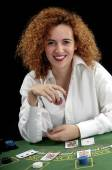 Woman croupier at the green table — Stockfoto